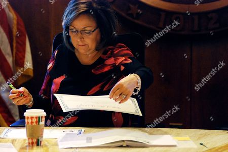 New Mexico Gov. Susana Martinez helps certify election results and order recounts in a handful of state House races in Santa Fe, N.M., on . New Mexico is certifying election results that give Democrats unfettered control of every statewide office and the state's five-member delegation to Capitol Hill