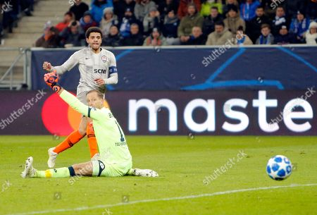 Shakhtar midfielder Taison scores his side's second goal during the group F Champions League soccer match between Hoffenheim and Shakhtar Donetsk at the Rhein-Neckar-Arena stadium in Sinsheim, Germany
