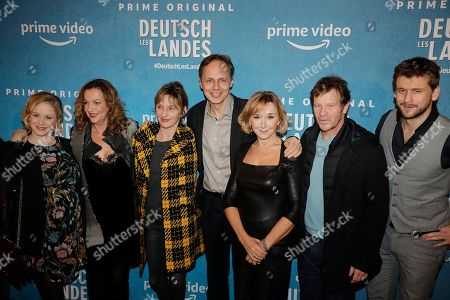 Jasmin Schwiers (L), German director Annette Ernst (2l), French director Denis Dercourt (C), and French actress Marie-Anne Chazel (3R), French actor Philippe Lelievre (2R) and French actor Gauthier Battoue (R) pose with others cast members during the premiere of the Franco-German comedy 'Deutsch-les-Landes' in Paris, France 27 November 2018.