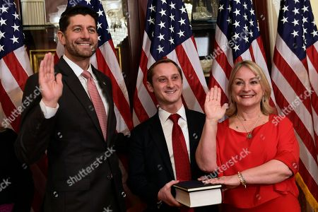 Paul Ryan, Susan Wild, Clay Wild. House Speaker Paul Ryan of Wis., left, poses during a ceremonial swearing-in for Rep.-elect Susan Wild, D-Pa., right, on Capitol Hill in Washington, . Wild's son Clay Wild, center, hold a copy of the Constitution