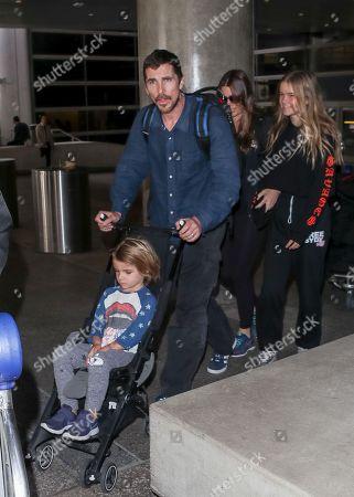 Stock Image of Christian Bale, Sibi Blazic, and children Joseph and Emmeline