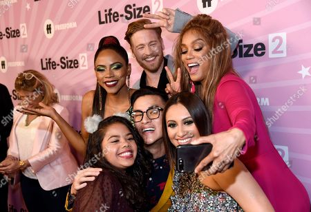 """Stock Picture of Shanica Knowles, Gavin Stenhouse, Tyra Banks, Alison Fernandez, Hank Chen, Francia Raisa. Shanica Knowles, from back row left, Gavin Stenhouse, Tyra Banks, and from front row left, Alison Fernandez, Hank Chen and Francia Raisa take a selfie as they arrive at the world premiere of """"Life-Size 2"""" at the Hollywood Roosevelt hotel, in Los Angeles"""