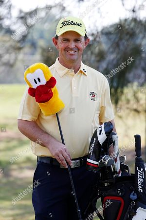Australian golfer Greg Chalmers poses with a driver cover to promote Yellow For Lyle Day during the Pro-Am of the Australian PGA Championships at the Royal Pines Resort on the Gold Coast, Australia, 28 November 2018.