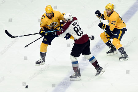 Stock Image of NAMES. Nashville Predators defenseman Yannick Weber (7), of Switzerland, collides with Colorado Avalanche left wing Matt Nieto (83) as they chase the puck during the third period of an NHL hockey game, in Nashville, Tenn. The Avalanche won 3-2